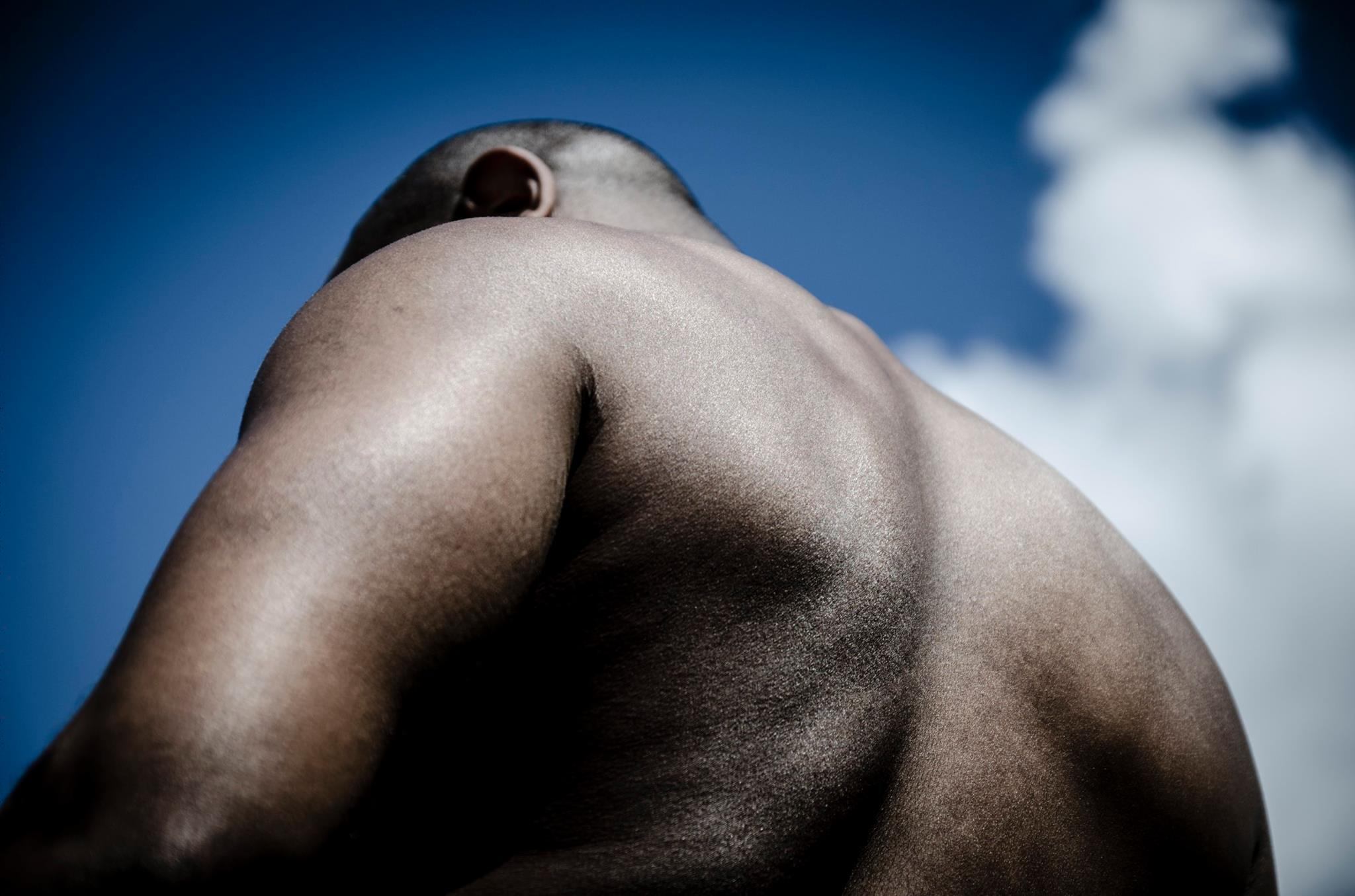 Jamahl Kersey, model, represents the moon in this photo by Arash Afshar, for Sarah Lujan's poem, Moon Baby.
