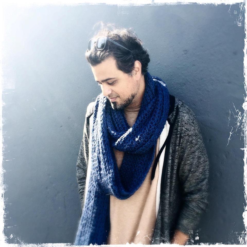 Head shot of Arash Afshar, Founder and Editor in Chief
