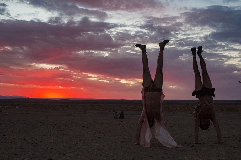 Afrika Burn 2019 handstands at sunset AfrikaBurn 2019 photo by Arash Afshar