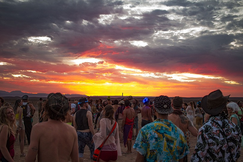 Crowd at sunset atAfrikaBurn 2019 photo by Arash Afshar