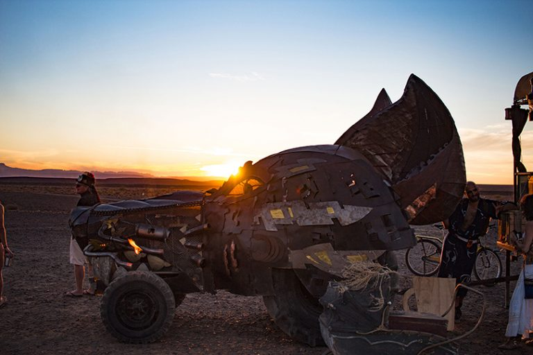 Afrika Burn 2019 rusty art car with sun setting behind it photo by Arash Afshar