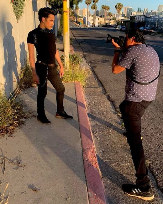 Arash Afshar photographing Adan Guerra on the street