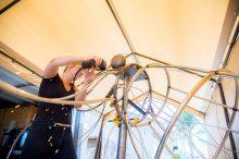 Kelly Schott welding on Ursula, a metal sculpture destin for Burning Man 2019