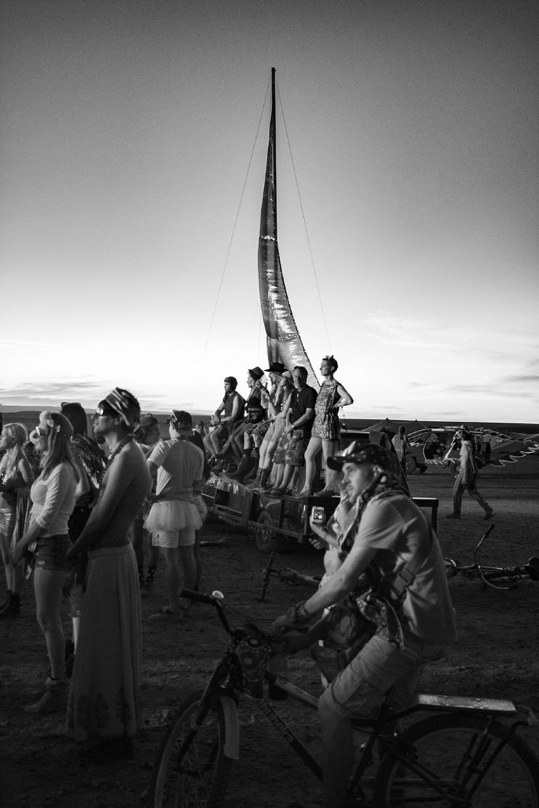 B&W vertical shot of crowd watching the Effigy Burn at AfrikaBurn 2019 photos by Arash Afshar