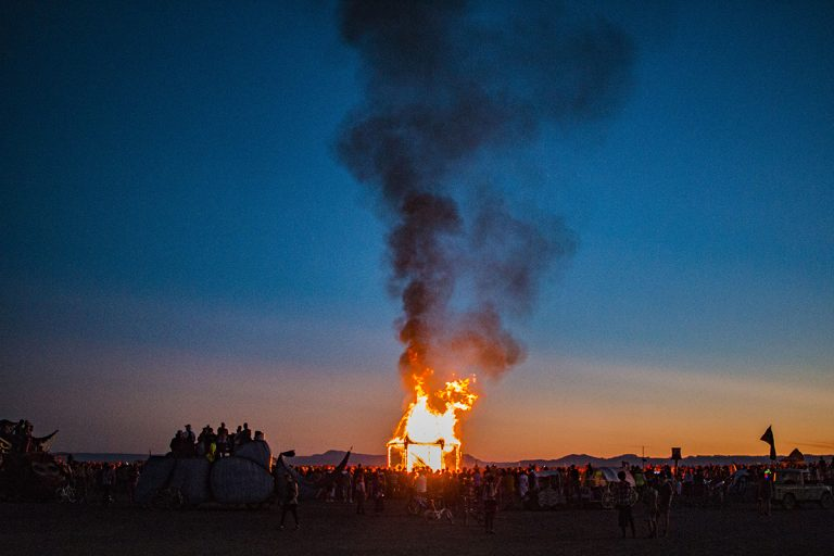 Effigy Burn at AfrikaBurn 2019 from a distance with full view of crowd AfrikaBurn 2019 photos by Arash Afshar