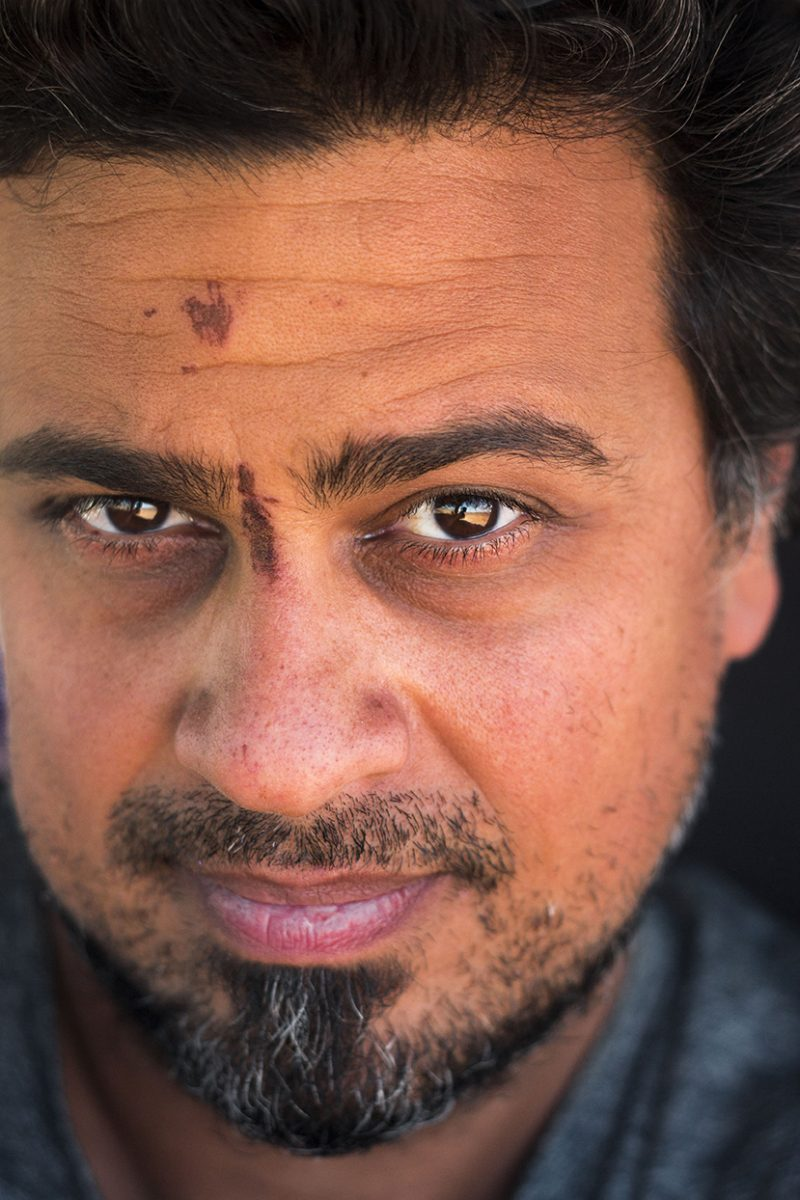 Close-up of Arash Afshar headshot with a scratch on his forehead and between eyebrows