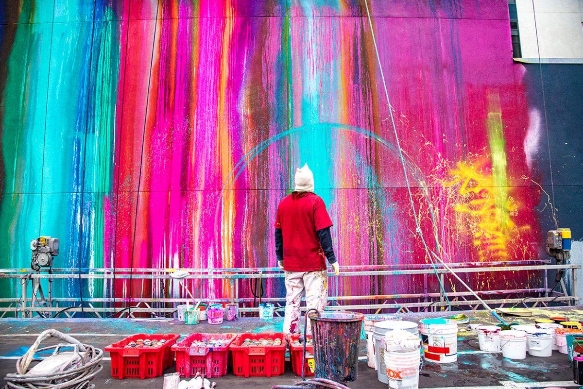 Graffiti artist Risk paints at San Diego's Quartyard